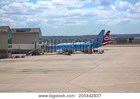PALMA DE MALLORCA - August 14:  Planes preparing for take off at Palma de Mallorca Airport on August 14, 2017 in Palma, Spain. Palma airport is major hub for tourists coming to the island