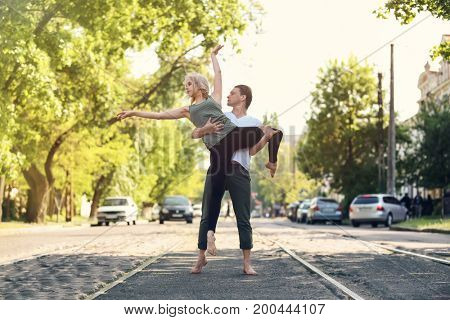 Passionate couple dancing outdoors