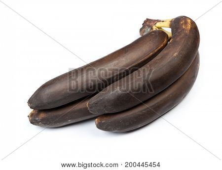 Bunch of black bananas isolated on white background
