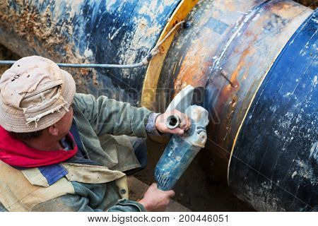 Sparks From Cutting Metal. Repair Of Heating Duct. The Workers, Welders Made By Electric Welding And
