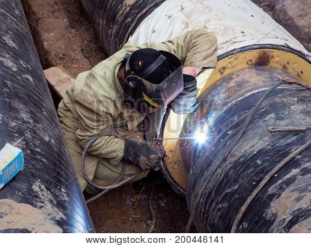 Repair Of Heating Duct. The Workers, Welders Made By Electric Welding And Gas Welding On Large Iron
