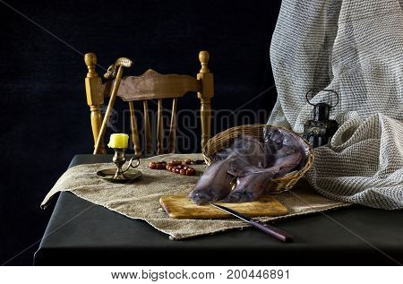 Still life with fish sole (flounder) in a basket on a table close-up