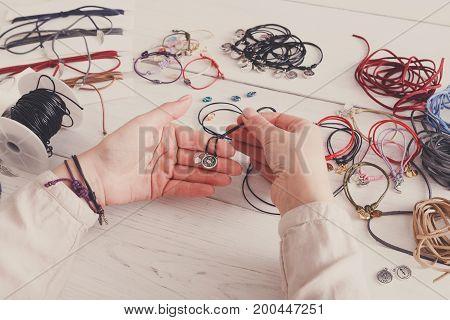 Handmade jewelry making, female hobby. Woman creating bracelet at home workshop, artisan pov. Fashion, handicraft concept