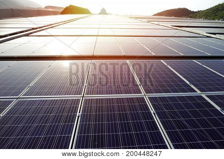 Solar PV Rooftop System on Warehouse Roof at Sunset