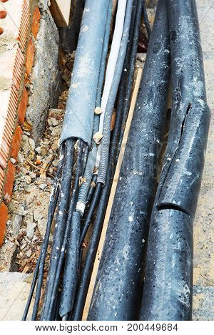 Pipes And Cables. Old Underground Cable Communication Lines, Optical Communication Networks. Repair