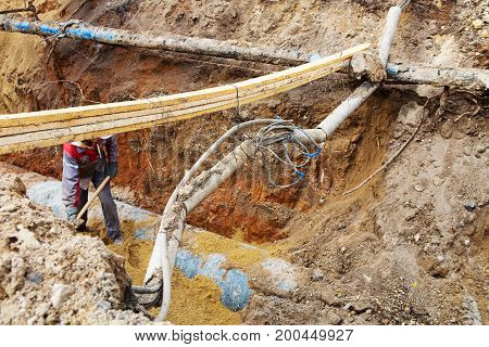 Pipes And Cables. Repair Of Communications. Water Supply, Electricity, Sewerage. Excavated Roads In