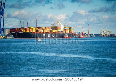 KLAIPEDA, LITHUANIA-AUG 14, 2017:MSC containership BREMEN in Klaipeda port. Mediterranean Shipping Company S.A. (MSC) is the world's second-largest shipping line in terms of container vessel capacity.