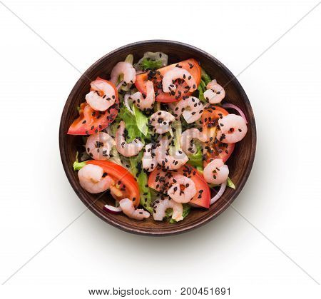 Healthy japanese restaurant food isolated at white. Bowl of shrimps and iceberg lettuce, tomatoes salad with red onion and black sesame. Asian fusion cuisine, above view