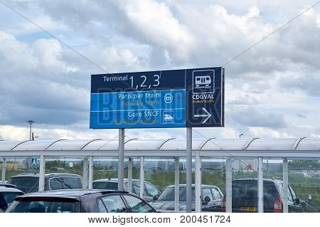 PARIS FRANCE - MAY 14 2017 : Charles De Gaulle Airport Parking and direction signs to terminals.