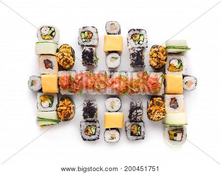 Big party sushi set isolated on white background. Japanese food delivery and take away. Fish and vegetable rolls with cheese and cucumber and spicy gunkans, top view