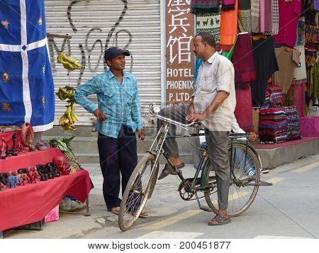 Kathmandu, Nepal, september 4, 2015: Rush in streets of Thamel, the tourist place in Kathmandu, Nepalese men's chatter