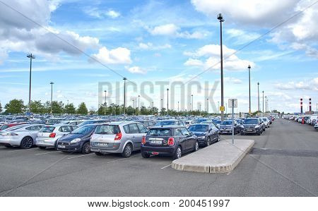 PARIS FRANCE - MAY 14 2017 : Charles De Gaulle Airport Parking and cars