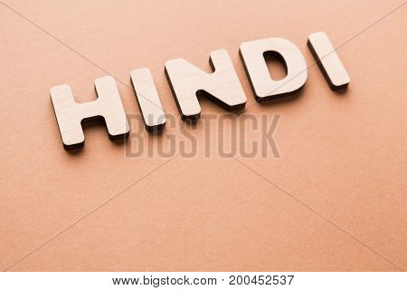 Word Hindi on beige background. Foreign language learning, education concept