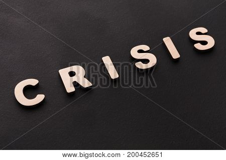 Word Crisis on black background. Unfortune, failure, bad luck concept