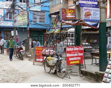 Kathmandu, Nepal, september 4, 2015: Rush in streets of Thamel, the tourist place in Kathmandu, Trader with bicycle sells the fruit