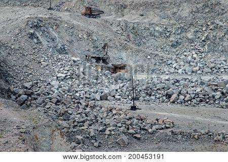 Trucks and escalators work in a granite quarry Ukraine Zaporozhye.