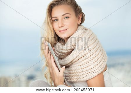 Portrait of a beautiful student girl with tablet at home, smart female working on touch pad, with pleasure using modern technology and wireless internet