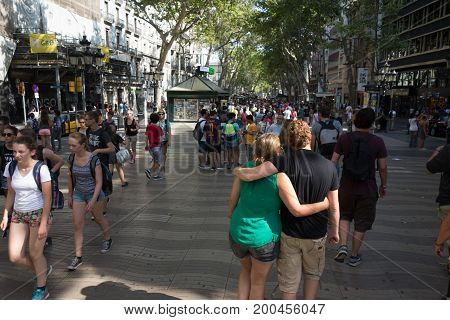 Barcelona, Spain. July 25, 2015:Crowd of anonymous people walking on the Rambla of Barcelona. This is the place where occurred the infamous terrorist attacs in Barcelona on August 17, 2017.
