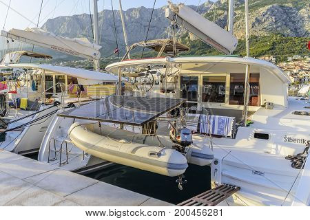 MAKARSKA RIVIERA, CROATIA - 10 JULY, 2017: Boats on the pier in the resort town of Makarska, Croatia. Makarska, one of the most popular destinations for beach holidays for tourists in Croatia.