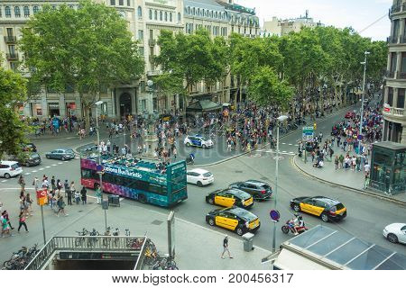 Barcelona, Spain. July 01, 2017:Crowd of anonymous people walking , police car and taxis , police car and taxis on the Rambla of Barcelona. This is the place where occurred the infamous terrorist attacs in Barcelona on August 17, 2017.