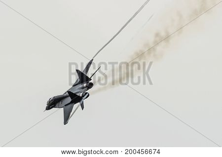 Aircraft Fighter Flies Sharply Turns With Smoke From Engines