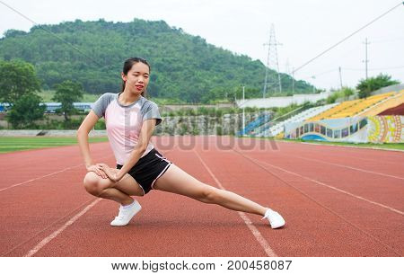 Girl Warming Up On A Jogging Track