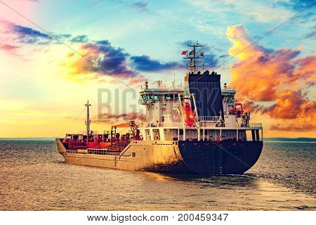 Oil Tanker on the sea at sunset.