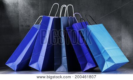 Composition With Blue Paper Shopping Bags