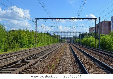 Railway. Four ways out in the distance. Electrified railway.
