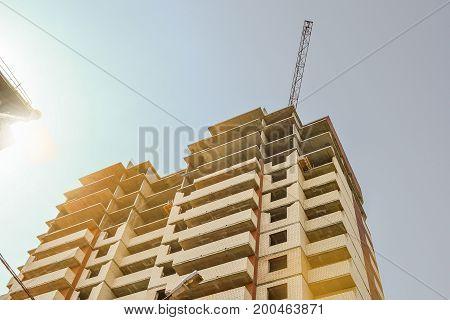 Multi-storey building under construction. Construction crane. Construction of modern housing. Building bussiness.