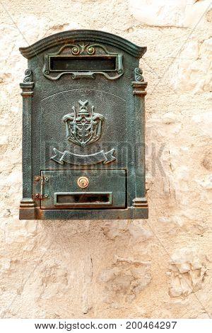 Antique Croatian postbox on stone wall in Sibenik, Croatia