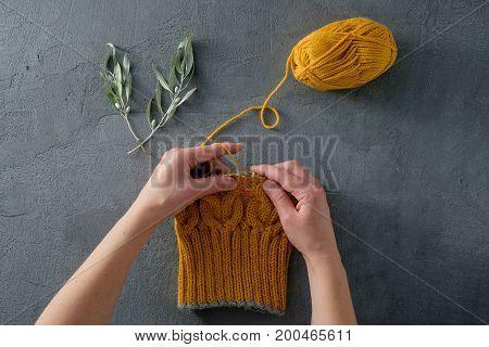 Hands Knit A Yellow Woolen Hat