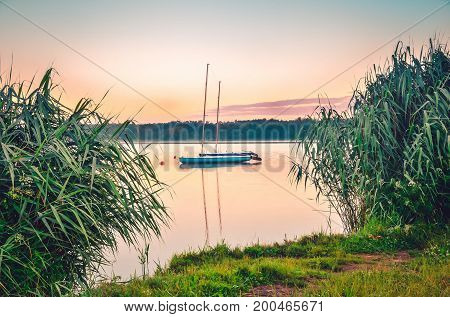 Boats on the water. Morning landscape by the lake.
