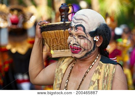 DENPASAR BALI ISLAND INDONESIA - JUNE 11 2016: Face portrait of traditional Balinese comedian Bondres on street parade at art and culture festival of Indonesian people.