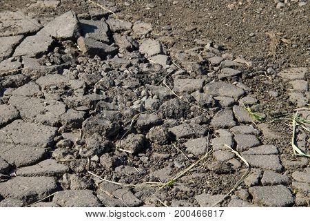 Smashed Asphalt. Closeup Of Broken Road