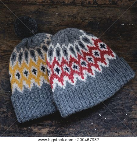 Two Grey Hats Made Of Wool With A Pompon