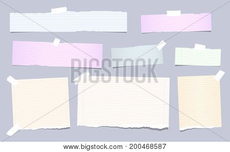 Colorful pastel, ripped, squared note, copybook, notebook paper strips stuck with sticky, adhesive tape on brown background