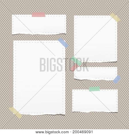 White ripped note, copybook, notebook paper with dashed line stuck on brown background
