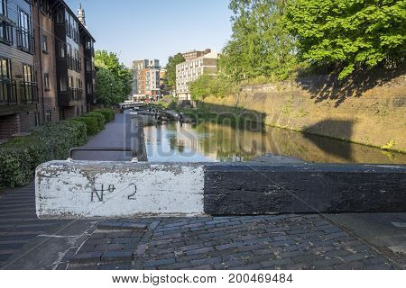 City centre / urban canal lock in Birmingham UK, with residential flats alongside the canal in the background