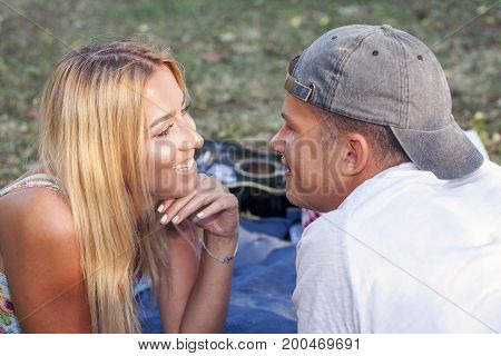 Couple In Love Enjoying  And Looking Each Other Face To Face