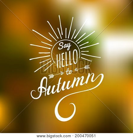 Vector hand lettering inspirational typography poster Say Hello to autumn with rays