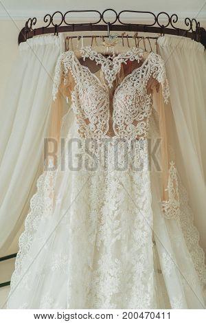 beautiful Wedding dress hanging in bridal suite