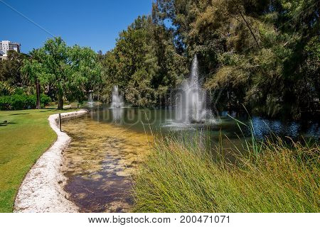 Fountains in a small pond at Government House gardens in Perth City Western Australia