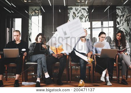 Creative Happy Hipsters Decide To End Their Work Days And Begin Of Weekend Through All Documents. Cr