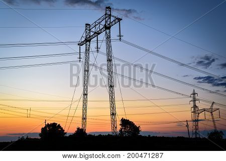 High voltage tower sky sunset background. High voltage