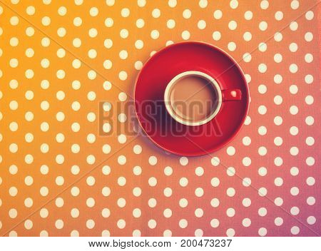 cup of coffee on speckled background. Above view