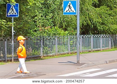 VINNYTSIA, UKRAINE - JUNE 25, 2017: In Vinniytsia the pedestrian mannequins were installed at the pedestrian crossing.The mannequin is made in the form of a child with a school armchair on which the inscription