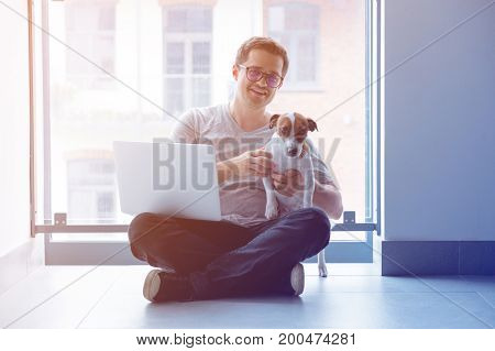 Handsome Young Freelancer Man Using Laptop Computer