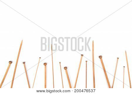 Wooden bamboo knitting needles frame on white background. Top view