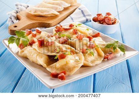 Cheese noodles on wooden background
